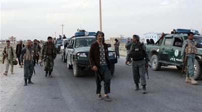 Afghan security forces patrol near the airport outside Kunduz  [Najim Rahim via AP]