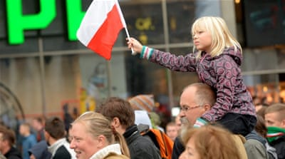 People march on September 12 against Poland's decision to offer asylum to Syrians and North Africans [Marcin Obara/EPA]