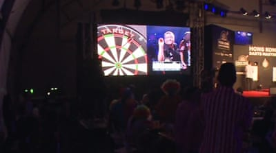 Darts hitting the bull's-eye in Hong Kong