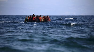Syrian refugees on a dinghy approach, in rough seas, a beach on the island of Lesbos, Greece [REUTERS]