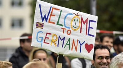 Germans welcomed arriving refugees with supplies and aid [Frank Rumpenhorst/EPA]