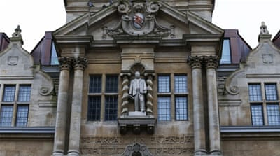 The statue of Cecil Rhodes is seen on the facade of Oriel College, Oxford  [REUTERS]