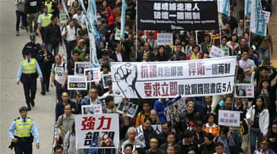 Thousands march in Hong Kong over missing publishers