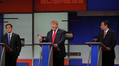 Republican US presidential candidate business tycoon Donald Trump speaks as rival candidates Senator Marco Rubio and Senator Ted Cruz  look on [Reuters]