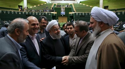 President Rouhani hails lifting of Iran sanctions