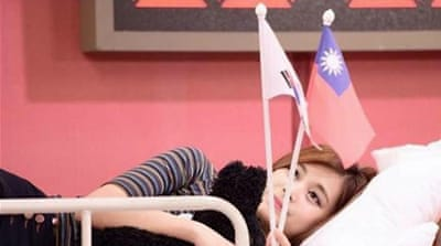 Chou Tzuyu was labelled a pro-independence activist after posing with a Taiwan flag [MBC]