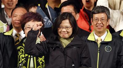 Tsai Ing-wen raises her hand as she declares victory in the presidential election, in Taipei, Taiwan [AP]