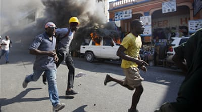 Opposition protesters have declared a 'week of rebellion' before Sunday's poll [Dieu Nalio Chery/AP]