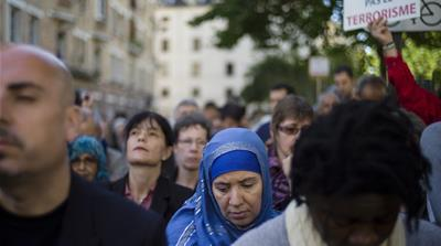 Muslims gather in Paris in September 2014 to pay a tribute to Herve Goudel, a mountain guide beheaded by fighters affiliated to the Islamic State of Iraq and the Levant [YOAN VALAT/EPA]