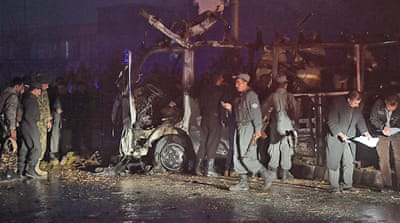 The suicide car bomber targeted a minibus carrying journalists during evening rush hour close to the national parliament in Kabul [AFP]