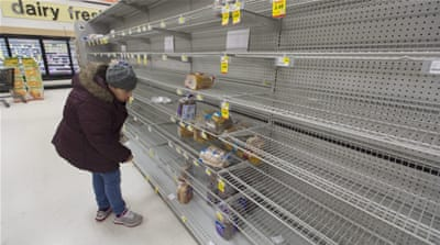Food and supplies have disappeared from grocery stores as residents prepare to hunker down during the storm [EPA]