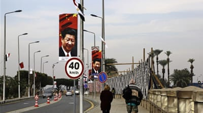 Xi's arrival in Egypt marked the first visit by a Chinese president to the country in 12 years [AP]