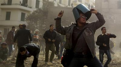 An opposition demonstrator throws a stone during rioting with pro-Mubarak supporters near Tahrir Square in Cairo (2011) [ REUTERS]