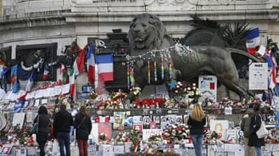 People pay tribute to the victims of shooting attacks at the Place de la Republique [Charles Platiau/Reuters]