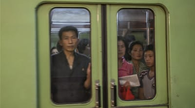 Children and adults emerge from a subway in Pyongyang [breathoflifestar]
