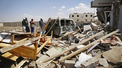 People inspect the site of an air strike in Yemen's capital Sanaa on Wednesday [Hani Mohammed/AP Photo]
