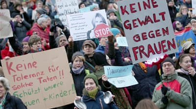 Rival groups protest in Germany over sex assaults
