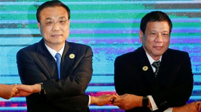 Duterte and Chinese Premier Li Keqiang at the ASEAN meeting in Laos last September [Reuters]