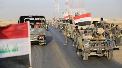 Iraqi security forces advance in Qayyarah, south of Mosul, to attack ISIL in Mosul, Iraq [Reuters]