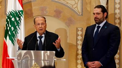 Michel Aoun during a news conference next to Lebanon's former prime minister Saad al-Hariri in Beirut, Lebanon [Reuters]