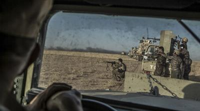 Peshmerga forces shoot during an operation to liberate several villages under ISIL control, southeast of Mosul, Iraq [EPA]