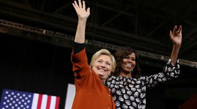 Obama made history by joining Clinton, for the first time, on stage on Thursday [Carlos Barria/Reuters]