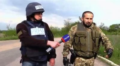 Journalist follows fighter in East Ukraine [Al Jazeera]