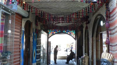 The entrance of the newly restored Farah Hotel in the heart of the Sulaimania Bazaar, Iraq [Lara Fatah/Al Jazeera]