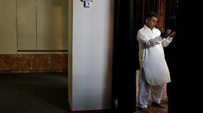 Muslims attend Eid al-Fitr prayers at a mosque in a basement, to mark the end of Ramadan, in Piraeus [Alkis Konstantinidis/Reuters]
