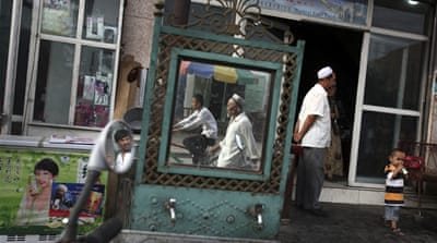 China: Xinjiang residents told to turn in passports