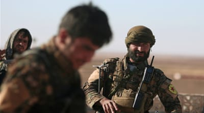 Syrian Democratic Forces (SDF) fighters are battling ISIS in areas north of Raqqa [Reuters]