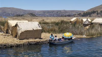 Peru and Bolivia vow to clean Lake Titicaca