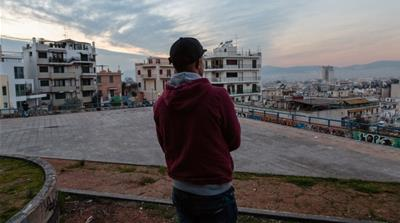 Mahmoud looks out over Athens. The young Afghan asylum seeker hoped to find a better life in Europe but has become trapped in a life of sex work in Greece [Will Horner/Al Jazeera]