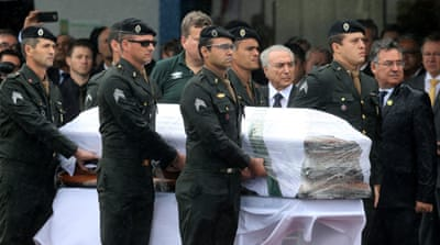 President Michel Temer receives the coffin of a Chapecoense player who died in the plane crash in Colombia [Paulo Whitaker/Reuters]