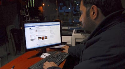 A Syrian man connects to his Facebook account at an internet cafe, in Damascus, Syria, on February 8, 2011 [AP]