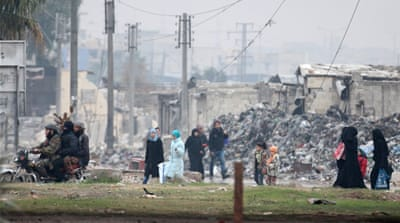 Civilians carry their belongings as they flee deeper into the remaining rebel-held areas of Aleppo [Reuters]