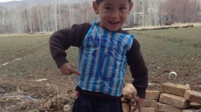 Photos of the boy wearing the improvised Messi jersey has touched a chord with football fans [Homayoun Ahmadi/Twitter]
