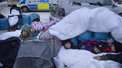 Syrian children sleep outside the Swedish Migration Board in Marsta outside of Stockholm [Reuters]