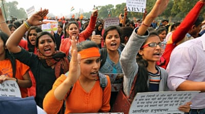Protesters in New Delhi on Friday called for the arrest of Kumar and other student leaders supporting Afzal Guru [EPA]
