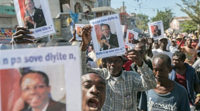 Opposition supporters protest in Haiti's capital Port-Au-Prince [EPA]