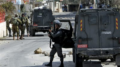 Israeli troops say they came under attack on Sunday before two 15-year-old boys were gunned down [Mussa Qawasma/Reuters]