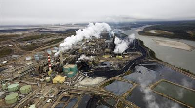 The Suncor tar sands processing plant near the Athabasca River at their mining operations near Fort McMurray, Alberta [REUTERS]