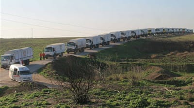 Aid convoys reach besieged Syrian towns