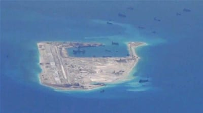 China has been asserting its presence in the disputed waters by building artificial islands [File:Reuters]