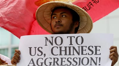 Filipinos protest against China's deployment of a surface-to-air missile system in the disputed South China Sea in front of the Chinese consulate in Makati city south of Manila, Philippines [EPA]