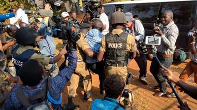 The opposition leader was taken to the Naggalama police station [Tendai Marima / Al Jazeera]