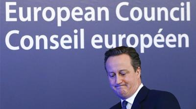 British Prime Minister David Cameron waves as he leaves a European Union leaders' summit in Brussels [REUTERS]