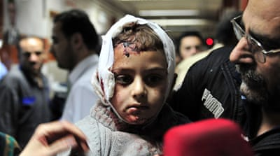 A wounded Syrian child receives treatment at a hospital in Damascus, Syria [EPA]