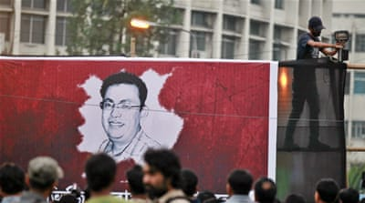People gather in Dhaka to protest against the murder of the Bangladeshi American blogger, writer and activist Avijit Roy on February 27, 2015 [Zakir Hossain Chowdhury/Barcro via Getty Images]