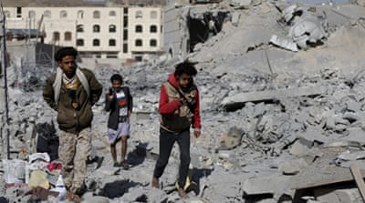 People walk through the rubble after a Saudi-led air strike in Yemen's capital Sanaa last month [Khaled Abdullah/Reuters]